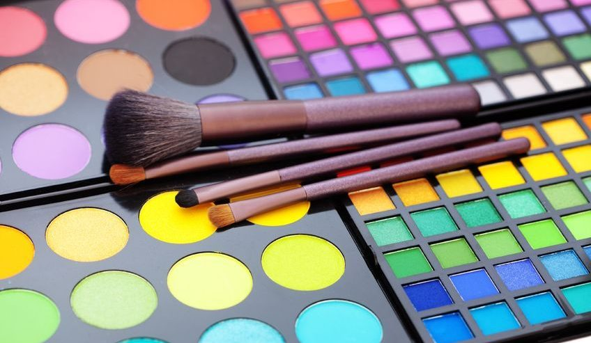 Colorful makeup palette with brushes